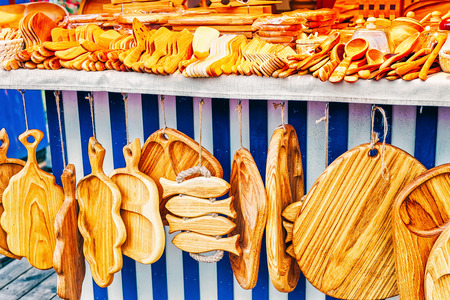 Wooden cutting boards and other kitchen accessories on sale at one of the stalls during the Christmas market in winter Riga in Latvia.