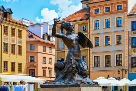 Warsaw, Poland - July 30, 2018: Syrenka mermaid statue on Old Town Market Square in Warsaw in Poland