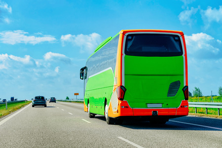 Green Tourist bus on the road in Poland. Travel concept.