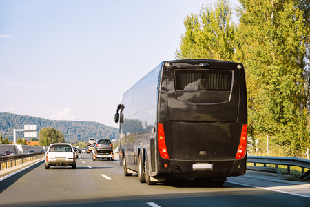 Black Tourist bus in the road in Poland. Travel concept. Stockfoto