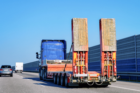 Truck without trailer box on the highway asphalt road of Poland. Truck transporter Archivio Fotografico