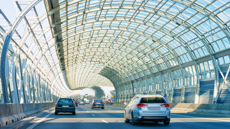 Car in a tunnel on the highway road in Warsaw, Poland. Stock Photo