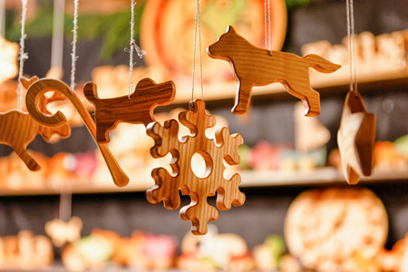 Stall with wooden toys decoration and Christmas market, in winter Riga in Latvia. Banco de Imagens