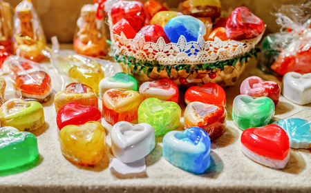Handmade soap souvenirs in Christmas market of Riga in Latvia in winter. Stock Photo