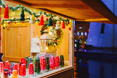 Festive stall with candles on Christmas market in Vilnius in Lithuania. Stock Photo