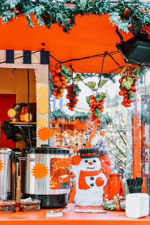 Stall with mulled wine on Christmas market in Riga in Latvia in winter. Stock Photo