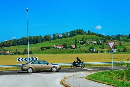 Scenery with hills and Car and motorcycle on the Road in Maribor in Slovenia Stock Photo