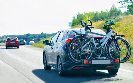 Car with bicycles in the road in Poland. Travel concept.