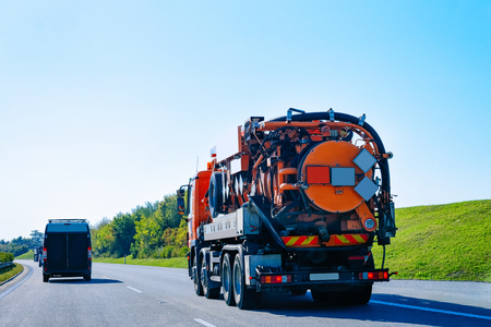 Vacuum waste truck on the highway road in Slovenia. Фото со стока