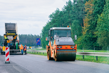 Road roller on the highway road in Poland.
