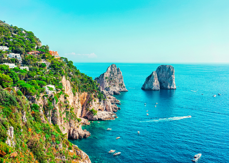 Capri Island with Faraglioni in Italy at Naples. Landscape with Blue Mediterranean Sea at Italian coast. Panorama of Anacapri in Europe. View in summer. Beautiful Amalfi scenery and Solaro mountain