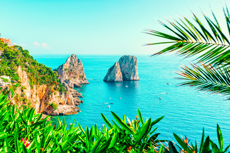 Capri Island and Faraglioni in Italy near Naples. Landscape with Blue Mediterranean Sea at Italian coast. Panorama of Anacapri in Europe. View in summer. Beautiful Amalfi scenery and Solaro mountain Stock Photo