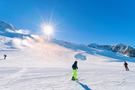 Skiers Men at Hintertux Glacier ski resort in Zillertal in Tyrol. Austria in winter in Alps. People at Alpine mountains with snow. Downhill fun. Blue sky and white slopes. Hintertuxer Gletscher. Stock Photo
