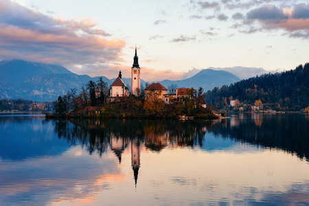 Beautiful landscape of Bled Lake and Church in Slovenia. Travel in Europe during sunset