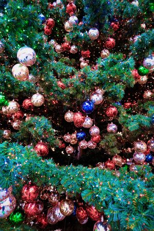 Fragment of Decorated X-mas Tree at Christmas market in Berlin in Germany in Europe in winter. German street Xmas and holiday fair in European town