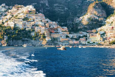 Citiscape and landscape at Positano town on Amalfi Coast and Tyrrhenian Sea in Italy, summer. View of beautiful Mediterranean architecture near Sorrento. Europe travel and tourism.