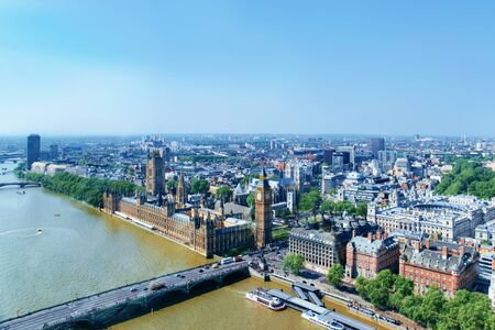 Aerial view on Big Ben at Westminster Palace in London old town in United Kingdom. Thames River in city capital of UK. England in spring. Bankside cityscape.