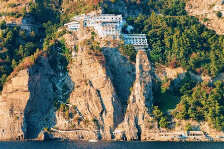 Citiscape and landscape at Positano town on rocks on Amalfi Coast and Tyrrhenian Sea in Italy in summer. View of beautiful Mediterranean coastline with architecture near Sorrento. Europe travel