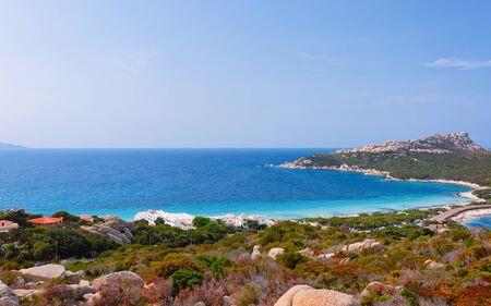 Scenery and road and beach near the coast of Capo Testa in Santa Teresa Gallura at the Mediterranean sea in Sardinia island, Italy. European Sardinian resort Stock Photo