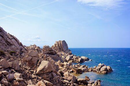 Stones and rocks on the Mediterranean sea at Capo Testa in Santa Teresa Gallura province on Sardinia island in Italy. Nature, mountains Stock Photo