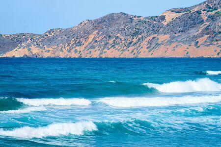 Mediterranean Sea in Buggerru in South Sardinia in Italy. Sardinian Italian resort with yellow sand in Sardegna. Archivio Fotografico - 129488775