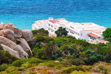 Landscape with villas at the Mediterranean sea in Capo Testa in Santa Teresa Gallura province on Sardinia island in Italy.