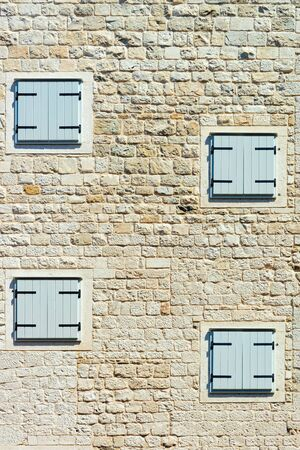 Window shutters on house of Roman Town architecture made of White brick at Diocletian Palace andin Old city of Split on Adriatic Coast in Dalmatia in Croatia. Cityscape of Europe tourism in summer.