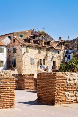 Ruins at Diocletian Palace and Roman Town architecture in Old city of Split on Adriatic Coast in Dalmatia in Croatia. Cityscape at Croatian Dalmatian Bay. Europe tourism and vacation in summer.