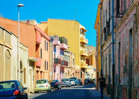 Street view on Road with car parked in Cagliari in Sardinia Island in Italy. Urban district