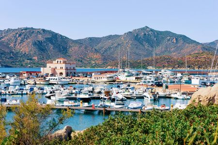 Old Sardinian Port and marina with ships near Mediterranean Sea in city of Villasimius in South Sardinia Island in Italy in summer. Cityscape with Yachts and boats Zdjęcie Seryjne