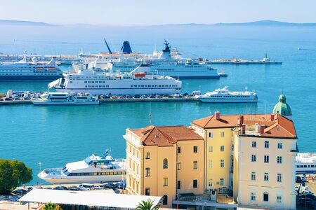 Cruise ships at Old city of Split on Adriatic Coast in Dalmatia in Croatia. Yacht at Roman Town architecture at Croatian Dalmatian Bay. Europe tourism and vacation in summer. Landscape and cityscape.