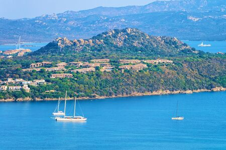Landscape and scenery at Golfo Aranci in Costa Smeralda in the morningg, Sardegna island in Italy in summer. Sassari province near Olbia and Cagliari. In the Mediteranean sea. Yachts, boats and ships Stock fotó