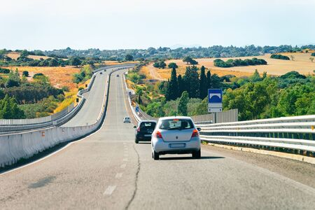 Cars in the road in Costa Smeralda in Sardinia Island in Italy in summer. Transport driving on the highway in Europe. View on motorway. Stock fotó - 129489098