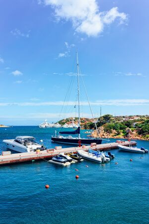Marina and luxury yachts in Mediterranean Sea in Porto Cervo in Sardinia Island in Italy in summer. View on Sardinian town port with ships and boats in Sardegna. Zdjęcie Seryjne