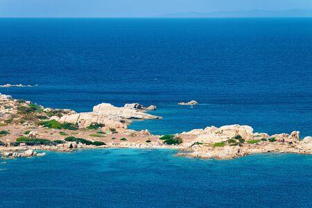 Scenery with beach near the coast of Capo Testa in Santa Teresa Gallura at Mediterranean sea in Sardinia island, Italy. European Sardinian resort Archivio Fotografico - 129489125