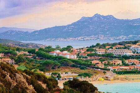 Landscape of Baja Sardinia luxury resort in Costa Smeralda at sunset in the evening, Sardegna island in Italy in summer. Scenery in Olbia province. In the Mediteranean sea