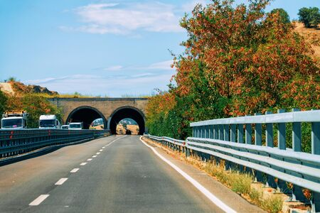 Scenery with the road and bridge in Carbonia near Cagliari in Sardinia in Italy.