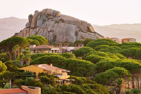 Landscape and scenery in Baja Sardinia luxury resort in Costa Smeralda at sunset in the evening, Sardegna island in Italy in summer. Olbia province. In the Mediteranean sea
