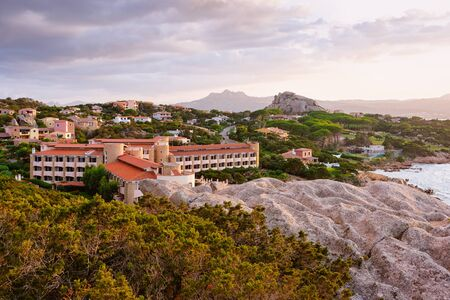 Landscape in Baja Sardinia luxury resort of Costa Smeralda at sunset in the evening, Sardegna island in Italy in summer. Olbia province. In the Mediteranean sea