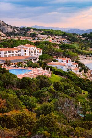 Landscape in Baja Sardinia luxury resort in Costa Smeralda at sunset in the evening, Sardegna island in Italy in summer. Scenery in Olbia province. In the Mediteranean sea