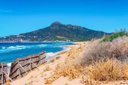 Beach at the Mediterranean sea in Buggerru, Carbonia-Iglesias province, in Sardinia, Italy