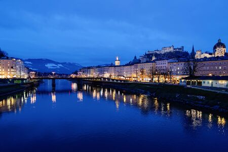 Panoramic view with Landscape of Old city and Hohensalzburg castle in Salzburg in Austria in Europe. Mozart town in Austrian Alps near Salzach River in winter. Fortress and Cathedral. In evening