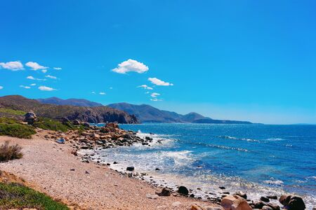 Beach in Capo Pecora at the Mediterranean Sea in Buggerru in South Sardinia in Italy. Sardinian Italian resort with yellow sand in Sardegna.