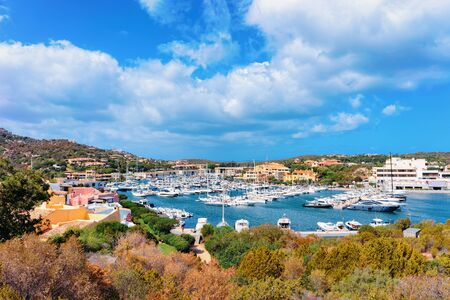 scenery with Marina and luxury yachts at Mediterranean Sea at Porto Cervo in Sardinia Island in Italy in summer. View on Sardinian town port with ships and boats in Sardegna. 免版税图像