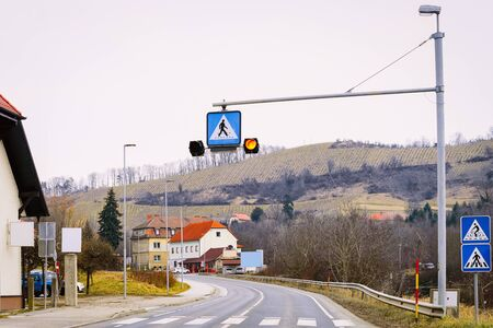 Road with pedestrian crossing in Maribor in Slovenia. Building architecture on background. Cityscape and street view Foto de archivo - 129526867