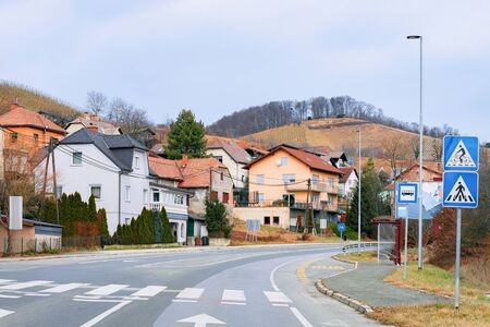 Road with pedestrian crossing in Maribor of Slovenia. Building architecture on background. Cityscape and street view Imagens