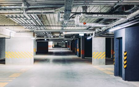 Europe Underground car parking garage in a modern apartment house Foto de archivo - 129527349