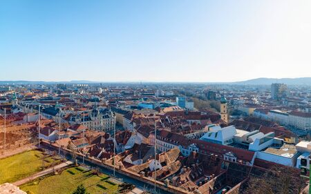 Panoramic view and cityscape with Rathaus on Hauptplatz and Town Hall square at Old city of Graz in Austria. Styria in Europe. Rooftop view from Schlossberg castle hill