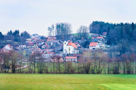 Panoramic view with Landscape in Old town in Austria in Europe. Small village in Austrian Alps. Building architecture and church. Road scenery