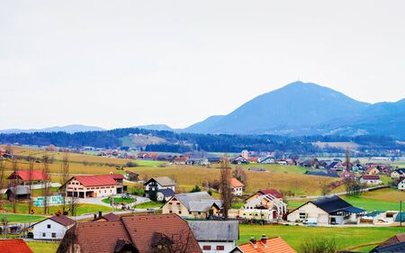 Panoramic view with Landscape and Old village in Austria in Europe. Small town in Austrian Alps. Building architecture. Road scenery